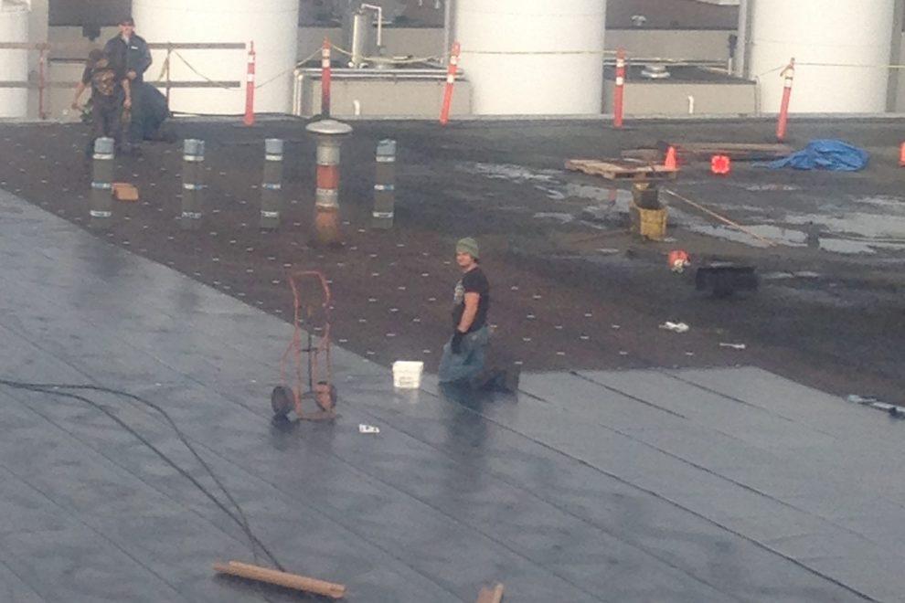 Roofing contractor men at work