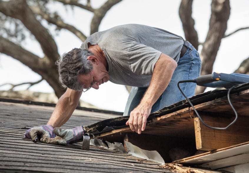 man is trying to extend roof life